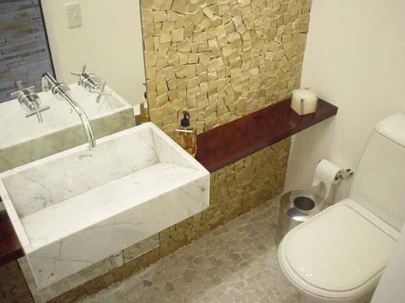 Pia esculpida na decoração do banheiro 008
