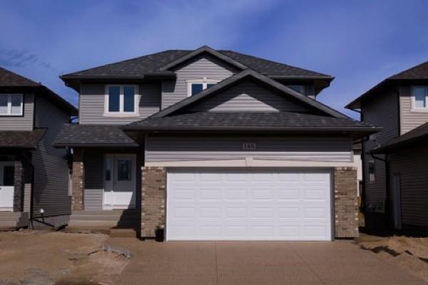 10-Frente de casas com garagem