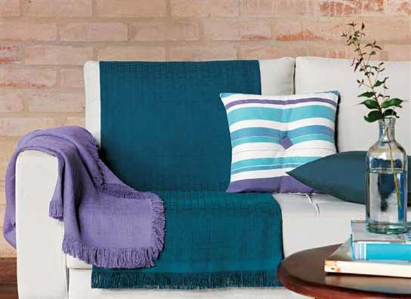 Combinações de almofadas e mantas na decoração